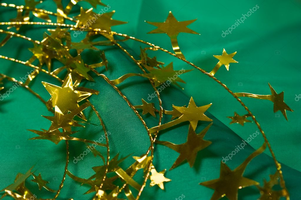 Christmas preparation:  holiday`s stars on the green background — Stock Photo #1229774