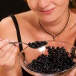 Girl with bilberries, - Stock Photo