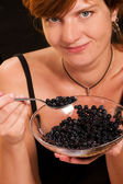 Girl with bilberries, — Stock Photo