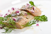 Macro picture of herring fillet on the plate — Stock Photo