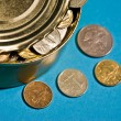 Tin with coins — Stock Photo