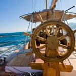 Yacht journey, steering wheel — Stock Photo