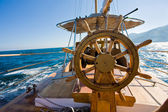 Yacht journey, steering wheel — Stok fotoğraf
