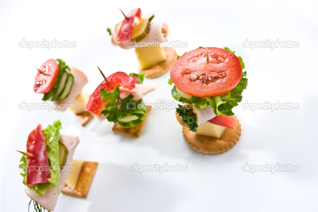 Food theme: cracker with ham, cheese and vegetables on the plate — Stock Photo #1281792