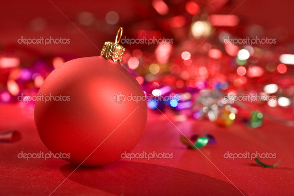 Holiday series: some red christms ball over red background  Stock Photo #1293794