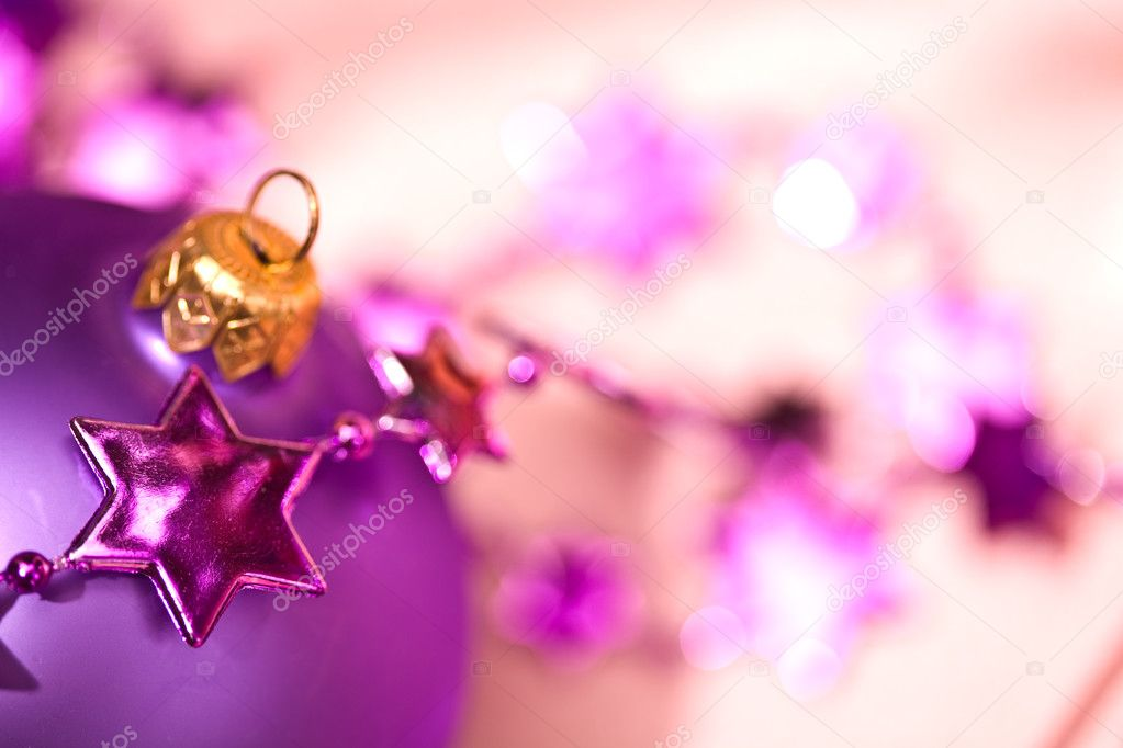 Holiday series: lilac christmas ball and starshaped garland  Stock fotografie #1297081