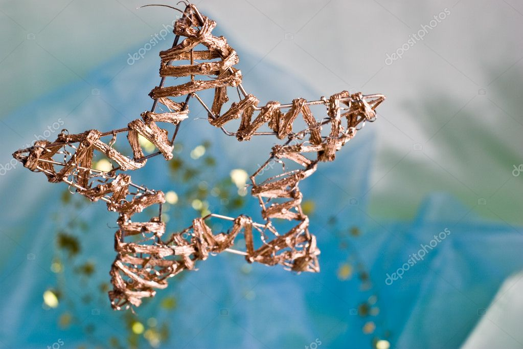 Holiday series: golden hand-made christmas star-shaped decoration — Stock Photo #1309080