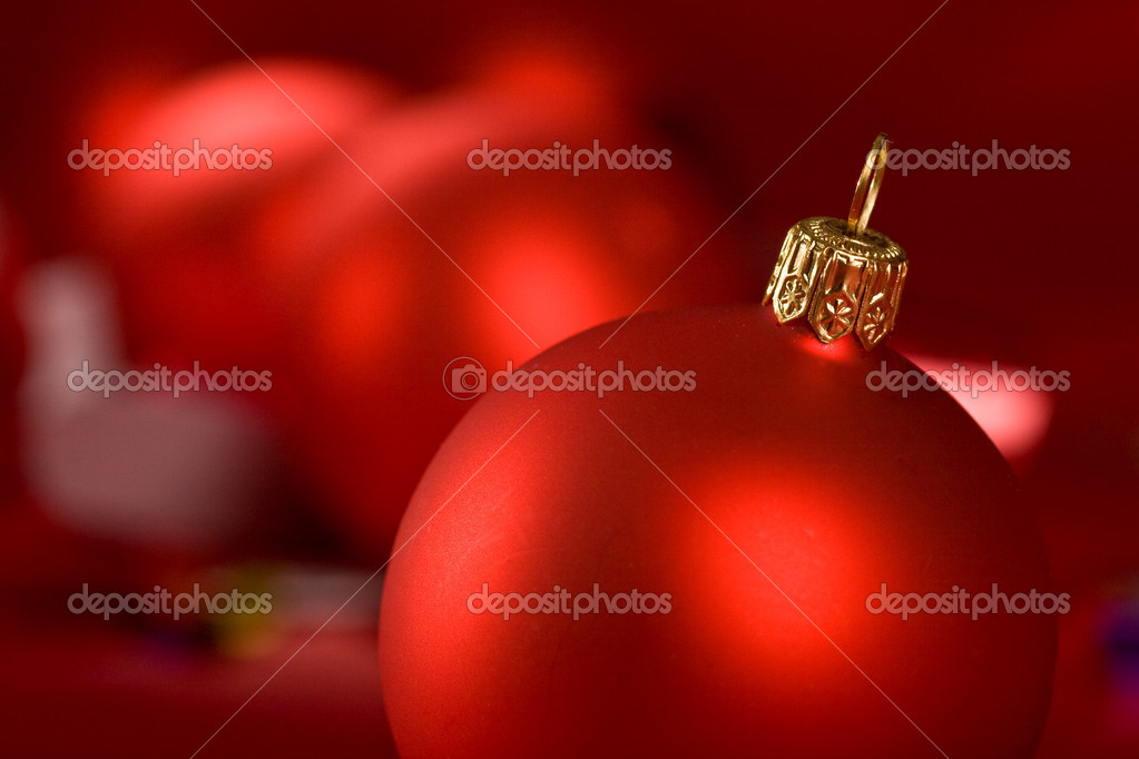 Holiday series: some red christms ball over red background — Stock Photo #1318775