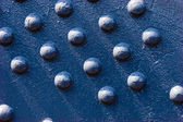 Texture series: blue color painted steel rivet — Stock Photo