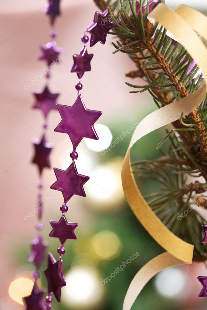 Holiday series: garland christmas stars on the tree — Stock Photo #1359757