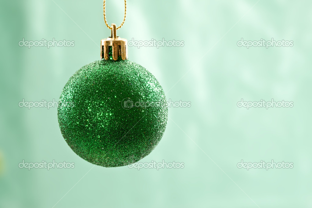 Holiday series: christmas green ball over light green background — Stock Photo #1377684
