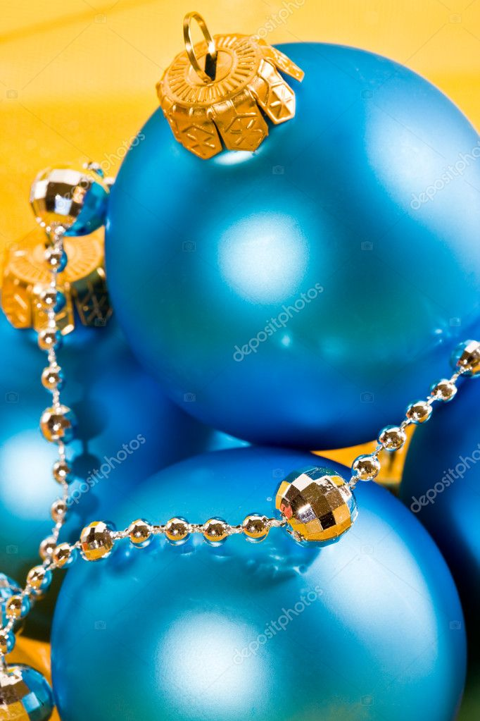 Holiday series: christmas blue ball and garland on yellow — Stock Photo #1377778