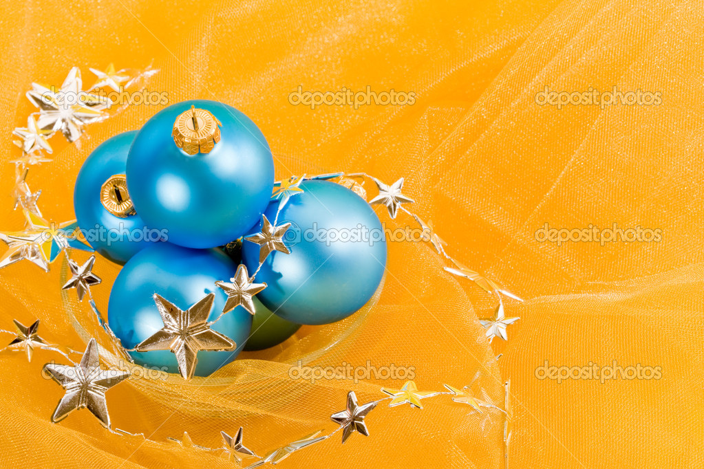 Holiday series: christmas blue ball with garland on yellow — Stock Photo #1377802