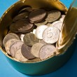 Tin with coins — Stock Photo #1396618