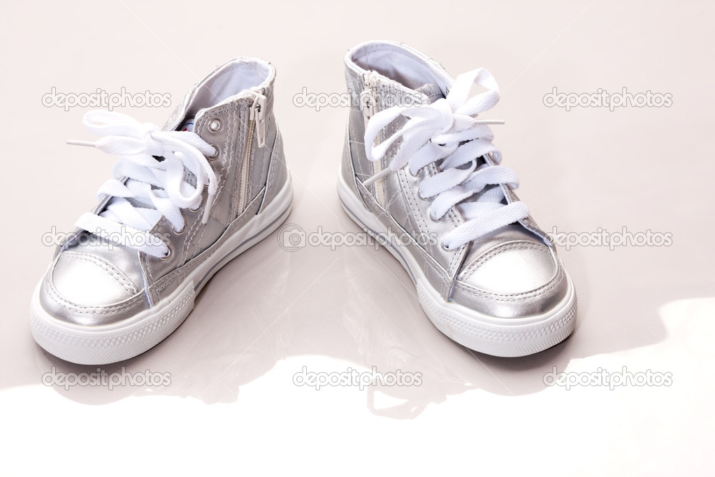 Fashion series: children's silver running shoes over white — Stock Photo #1390211