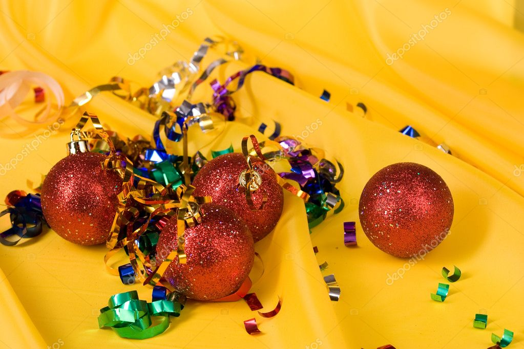 Christmas series: red balls over yellow background — Stockfoto #1423629