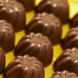 Stock Photo: Rows appetizing chocolate bonbon