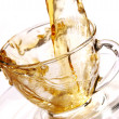 Golden stream of tea — Stock Photo