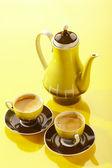 Gelbe kaffee-stilleben — Stockfoto