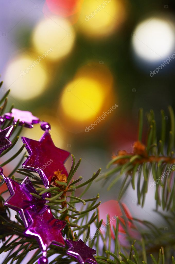 Detail of Christmas tree with garland - stars — Stock Photo #1457641