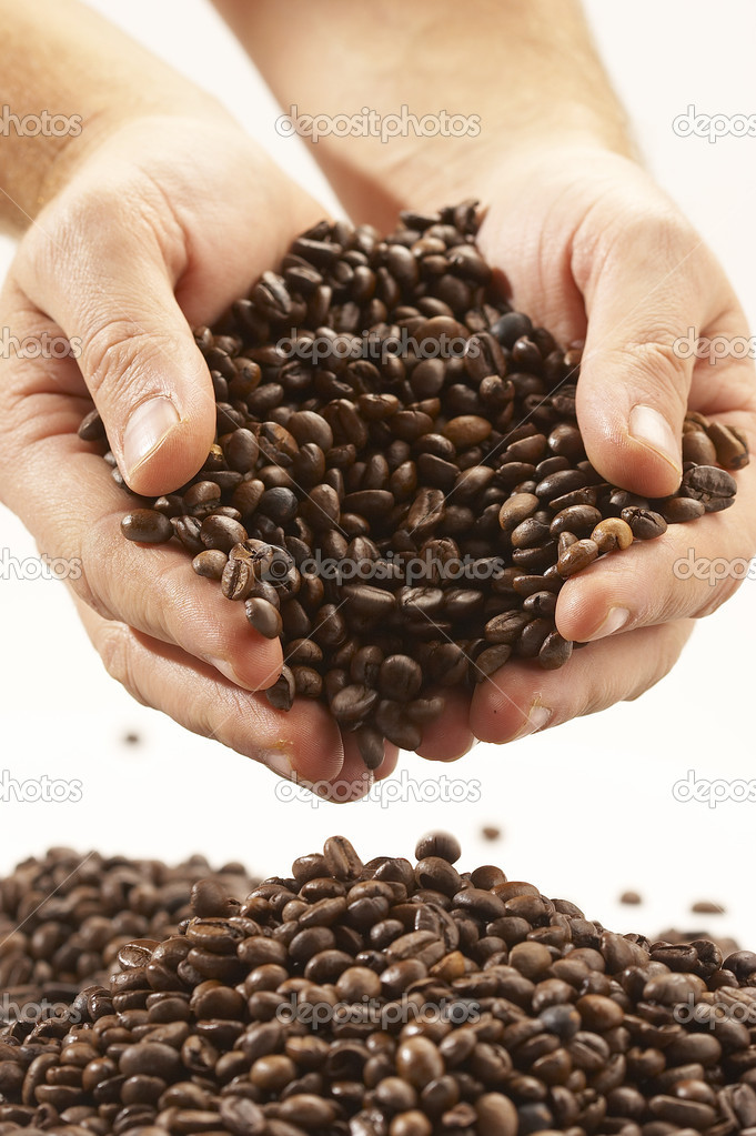 Coffee grains on the hands  Stock Photo #1460129