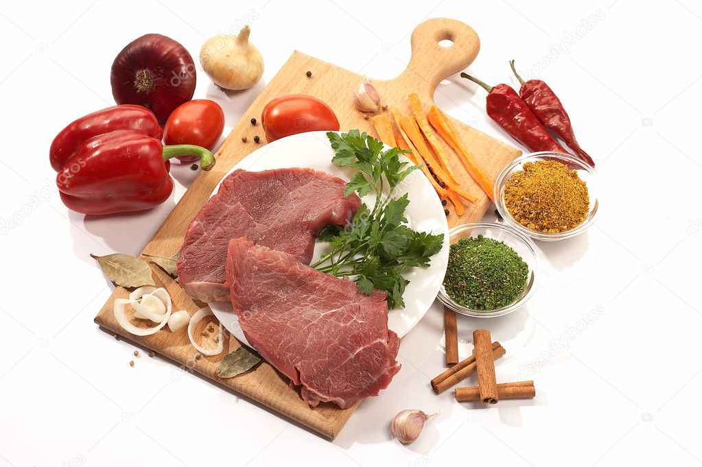 Foodstuff: meat and vegetables on the wood board — Stok fotoğraf #1464574