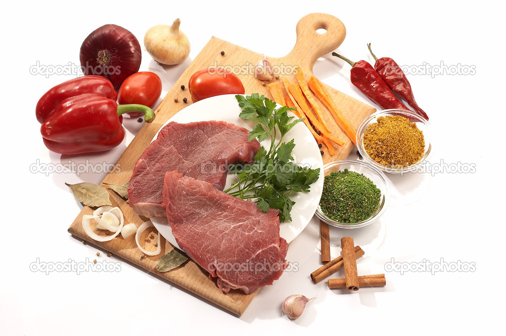 Foodstuff: meat and vegetables on the wood board — Stock Photo #1464574