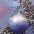 Royalty-Free Stock Photo: Xmas ball on silver fir