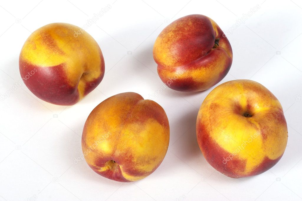 Four ripe appetizing nectarine over white background  Stock Photo #1471697