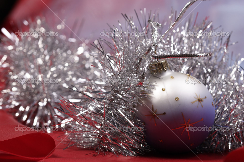 Christmas mood, ball with xmas decoration garland — Stock Photo #1474359