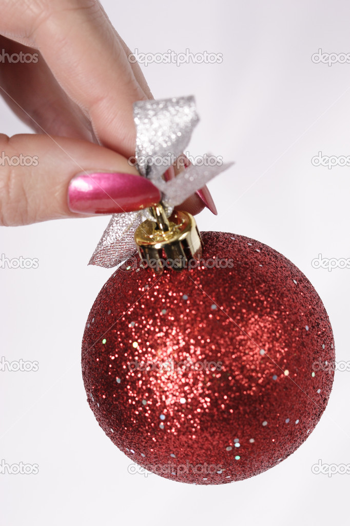 Red Xmas decorated bauble in hand — Stock Photo #1474442