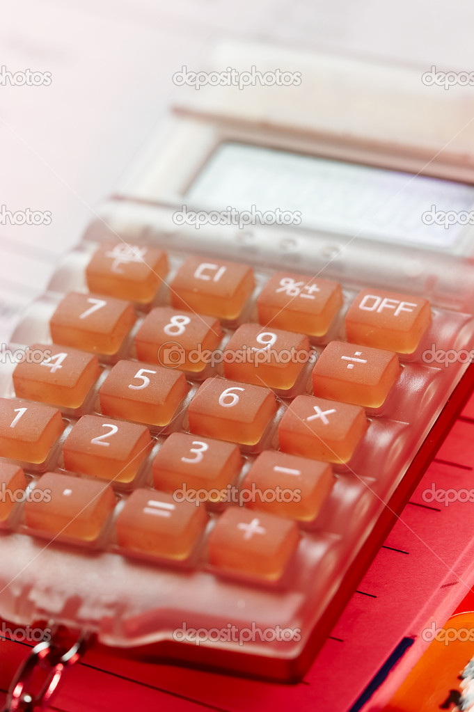 Business object: macro picture of orange small calculator — Stock Photo #1475187