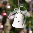 Stock Photo: Christmas bell with tree and lights on b