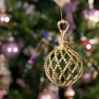 Christmas toy - ball with green tree and — Stock Photo