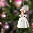 Christmas doll with tree and lights on b — Stock Photo