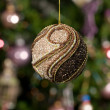 Christmas toy - beautiful ball with tree - Stock Photo