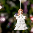 Stock Photo: Christmas doll with tree and lights on b
