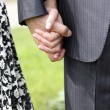 Close-up on young man and woman hands ho — Stock Photo