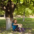 Pretty woman under tree — Stock Photo