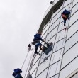 Group of workers washing windows in the — Stock Photo #1273825