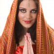 Indian girl in red shawl — Stock Photo