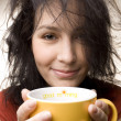 Positive girl with yellow cup — Stock Photo