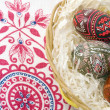 Ornamented Easter eggs in bin — Stock Photo