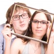 Happy pair in glasses in frame — Stock Photo #1273920