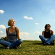 Two young sitting on the grass — Stock Photo