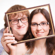 Stock Photo: Happy pair in glasses in frame