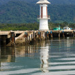 White lighthouse in bay on Koh Chang isl - Stock Photo