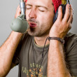 Young man singing in microphone - Stock Photo