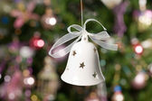 Christmas bell with tree and lights on b — Stock Photo
