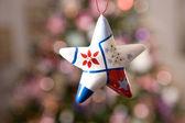 Christmas star with tree and lights on b — Stock Photo